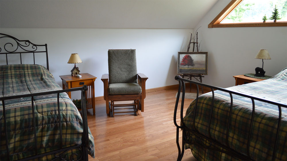The Lodge bedroom, containing a double bed and twin bed.